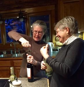 Janet opening uncorking wine.